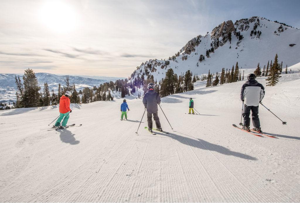 Skiers at Snowbasin Resort in Utah.